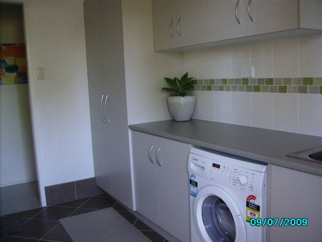 Laundry cabinet maker